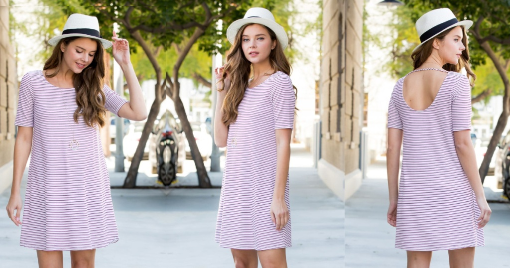 three woman wearing pink and white striped dress outside with city view and trees
