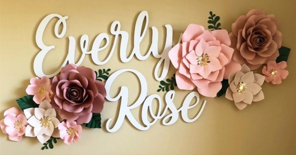 large name sign with pink flowers