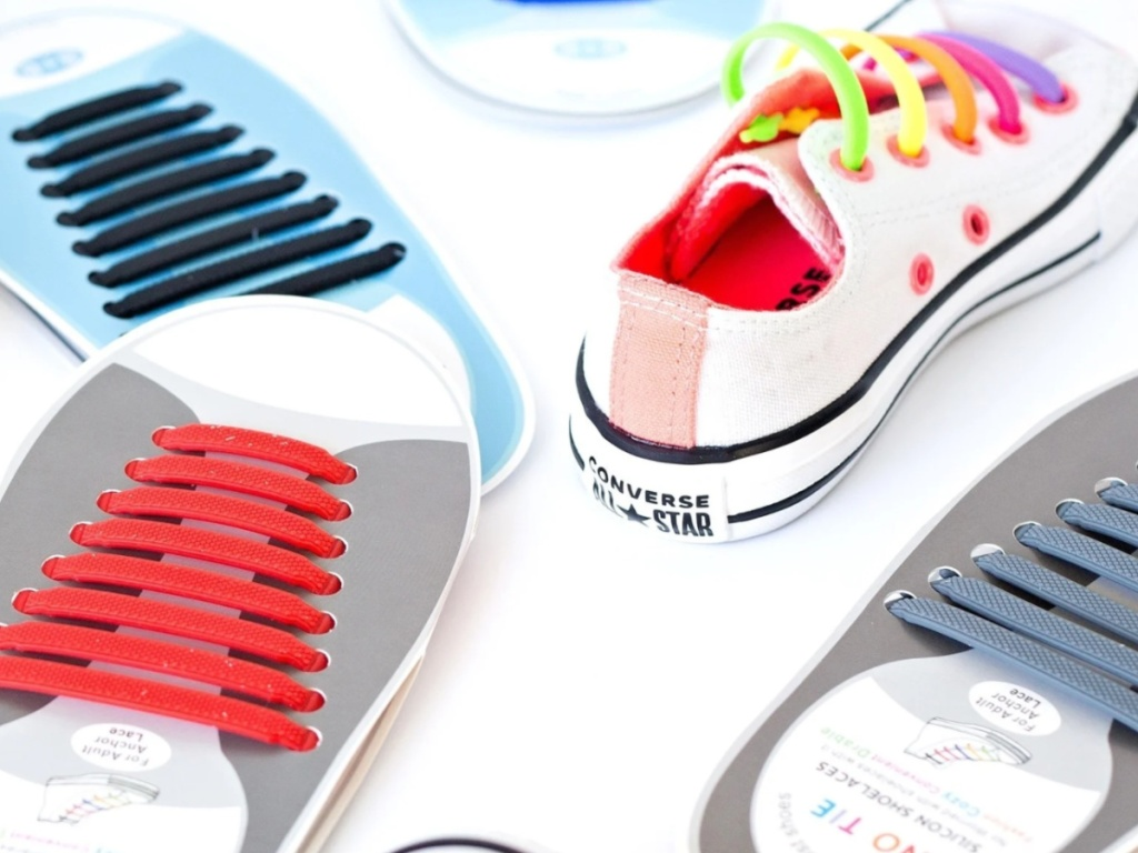 colorful no-tie silicone shoe laces on a sneaker and cardboard cut outs