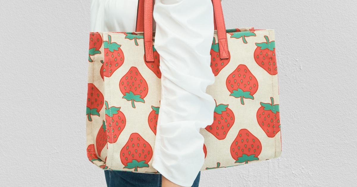 Woman wearing a Strawberry Print shoulder bag
