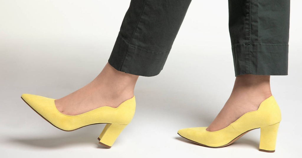 woman in pants wearing yellow pumps