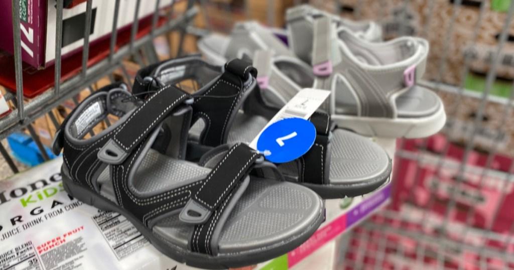 black women's sandals in store cart