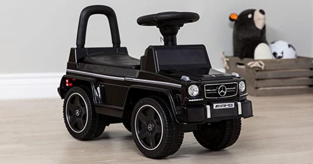black mercedes c63 push buggy in living room