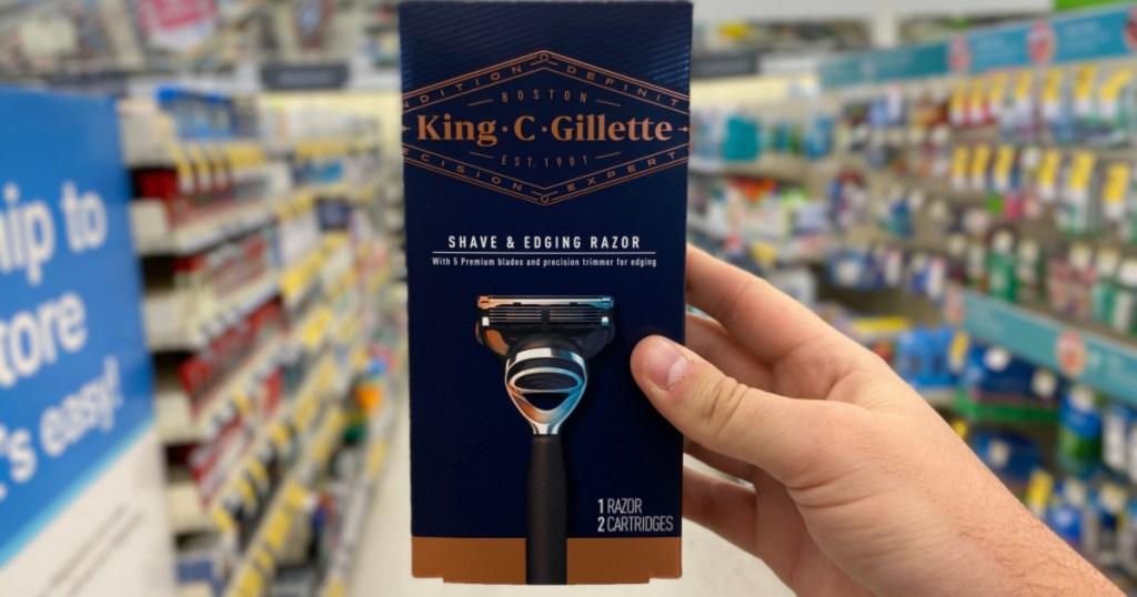 man hand holding up King C Gillette Razor