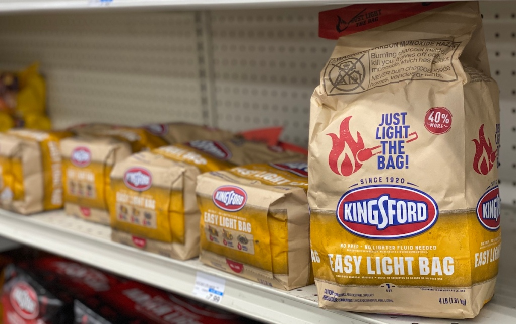 bag of Kingsford charcoal on shelf next to more bags