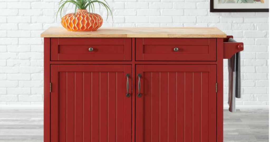 red cabinet with kitchen towel on side
