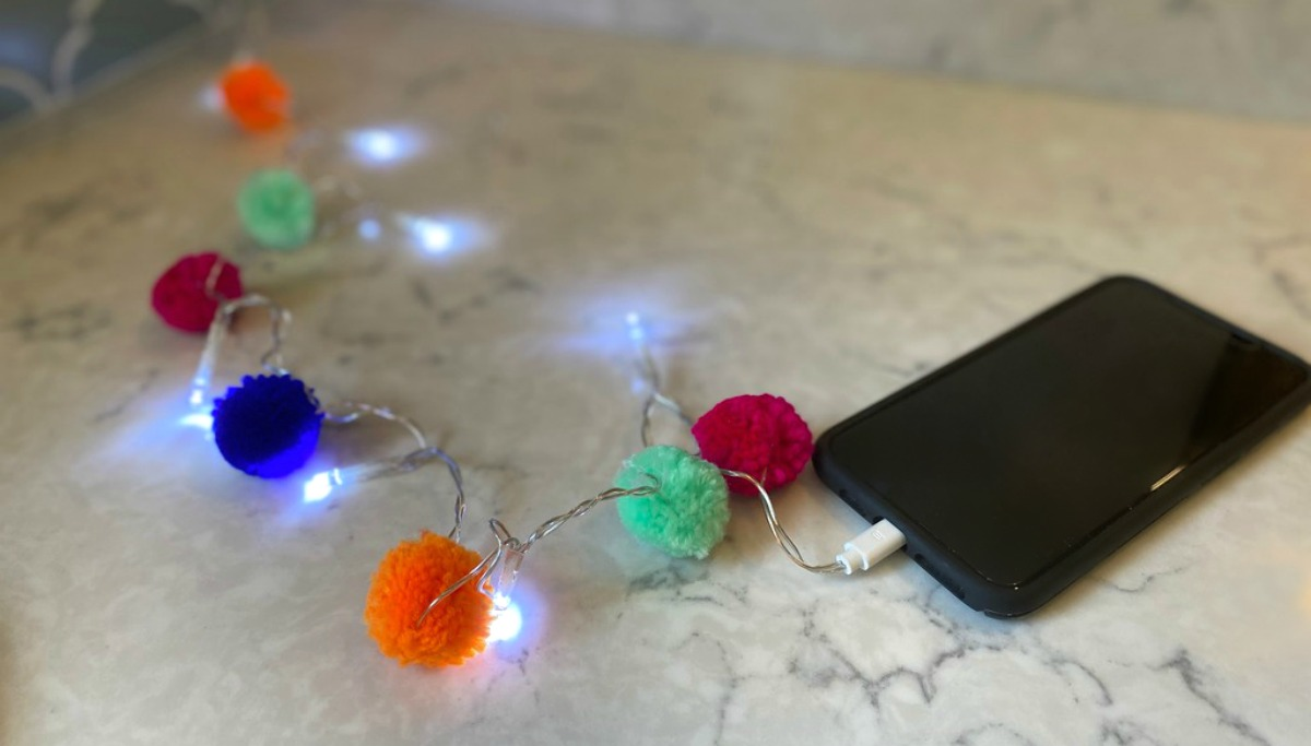 cell phone with pom pom charger cord