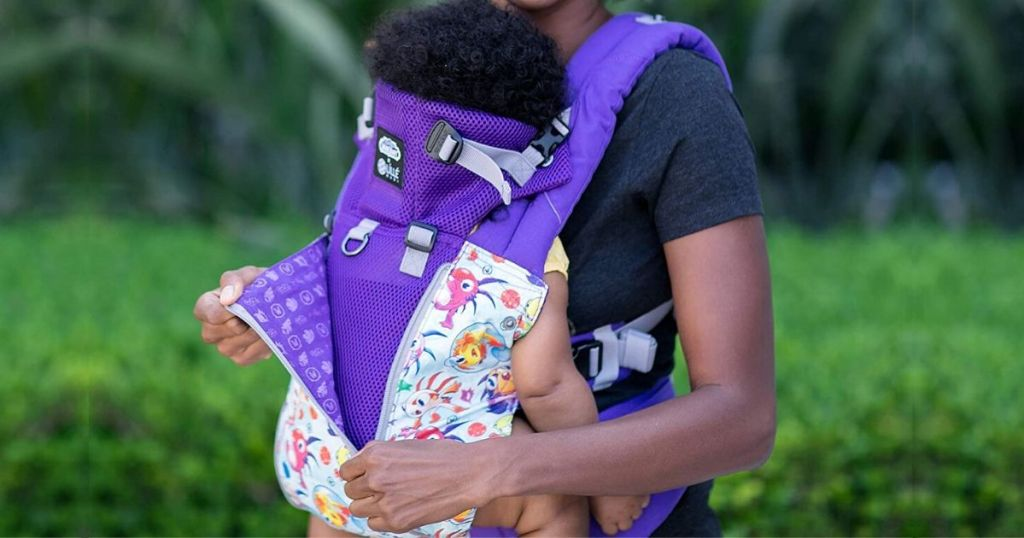 woman with baby in baby carrier