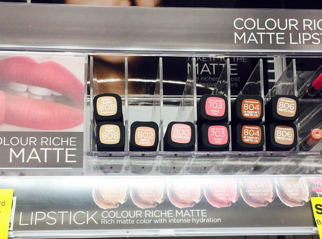 display of different shades of l'oreal lipsticks in store