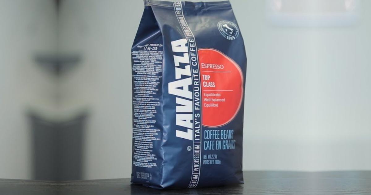 blue bag of coffee on dark table