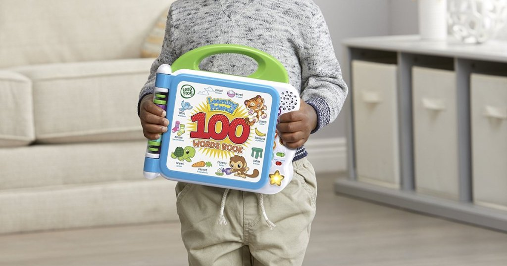 boy holding closed LeapFrog Learning Friends 100 Words Book
