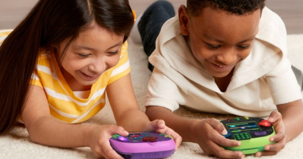 two children playing on electronic game devices