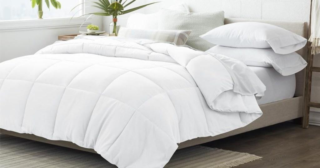 white comforter on bed in bedroom
