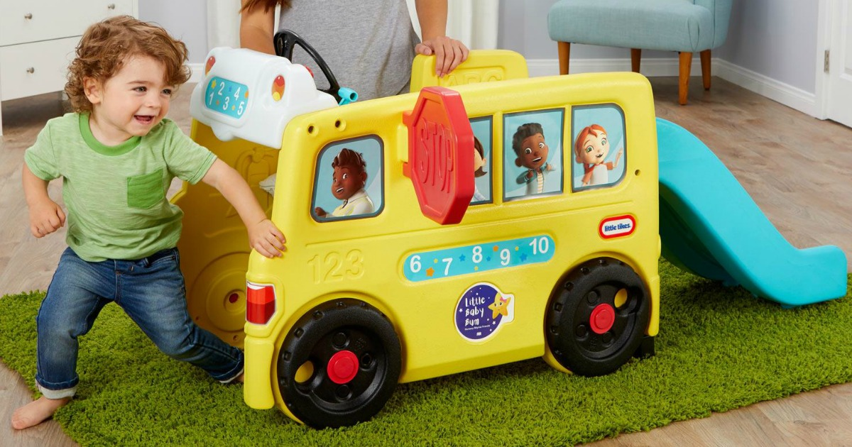 child playing with bus shaped climb on toy