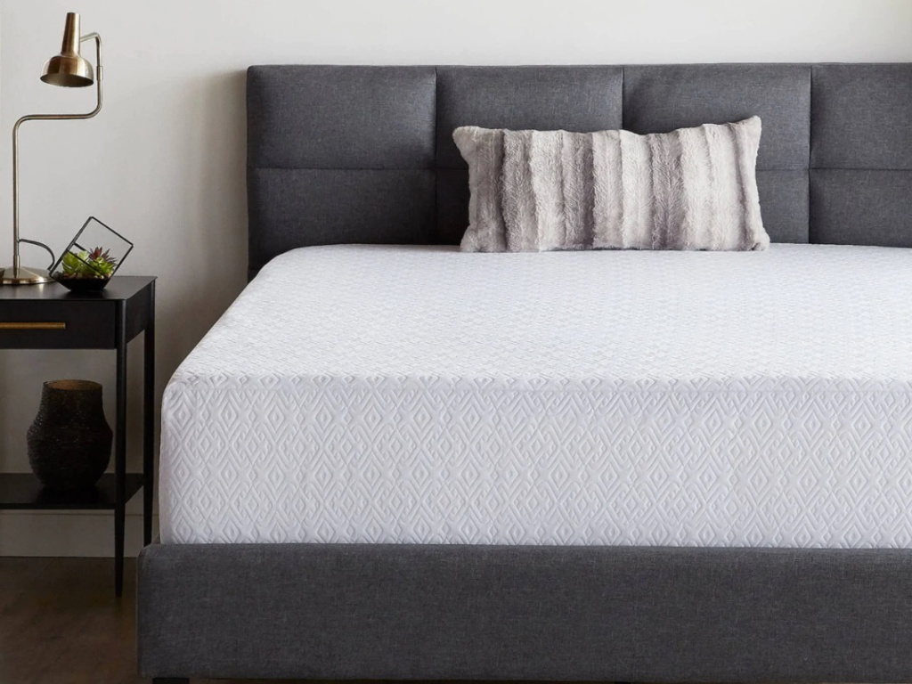 white memory foam mattress in charcoal colored bed frame in bedroom