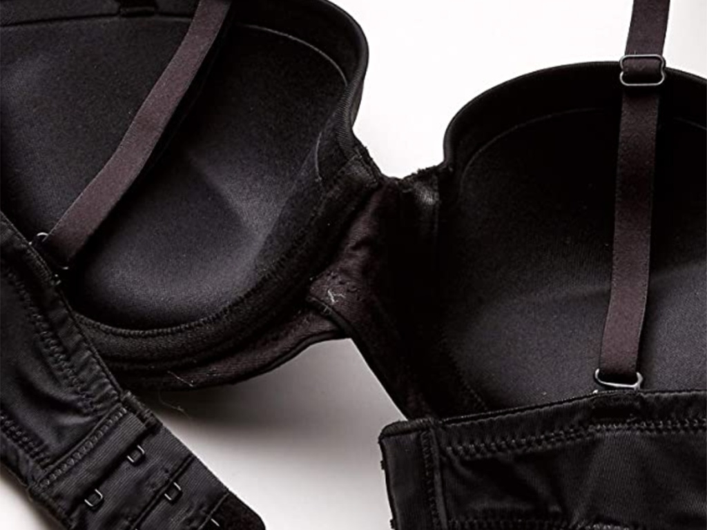 close up of the inside of a black strapless bra