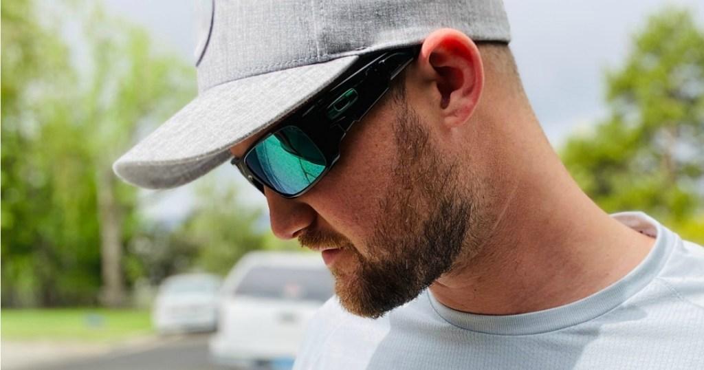 Man Wearing Oakley Crankshaft Sunglasses