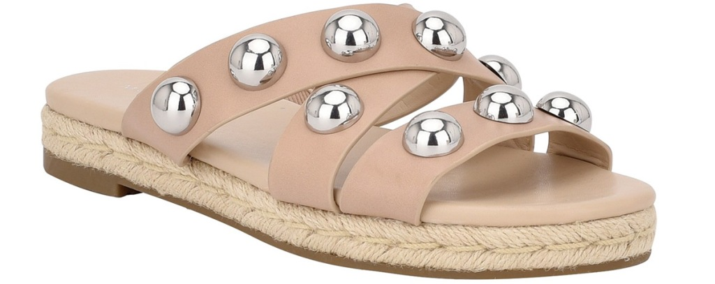 tan flat sandal with silver ball on top of straps
