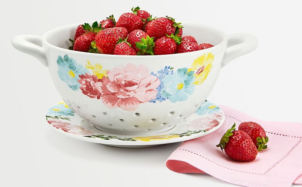 colander with strawberries in it
