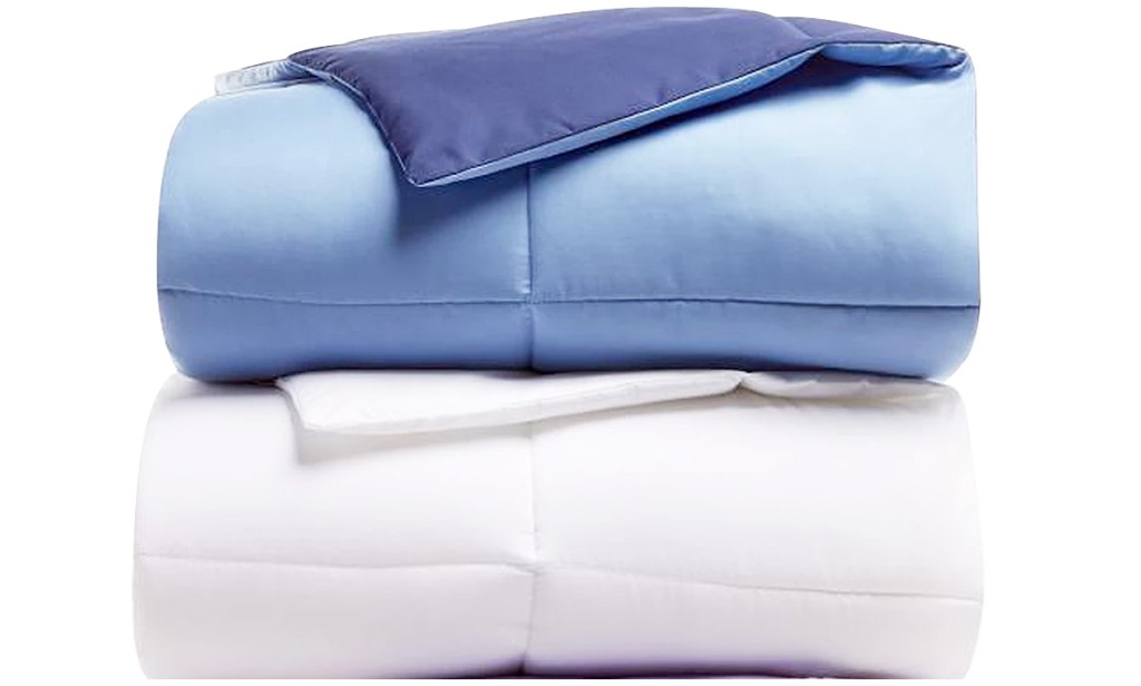 white and blue comforter sets folded and stacked on one another