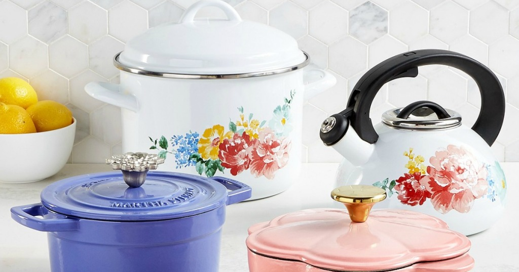 three dutch ovens and a teapot