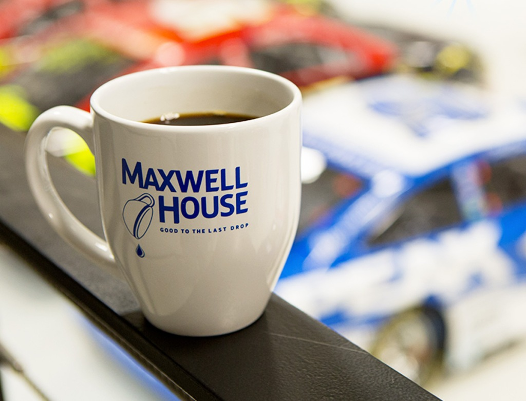 white coffee mug with blue text that says Maxwell House on it