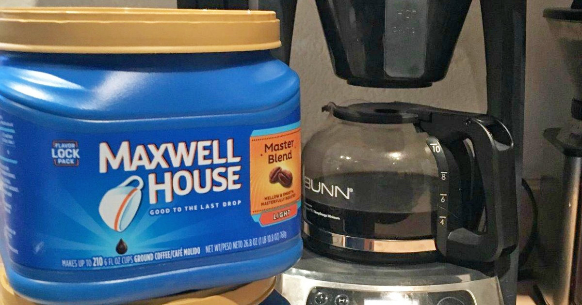 blue plastic container of Maxwell House Master Blend coffee in front of drip coffee machine