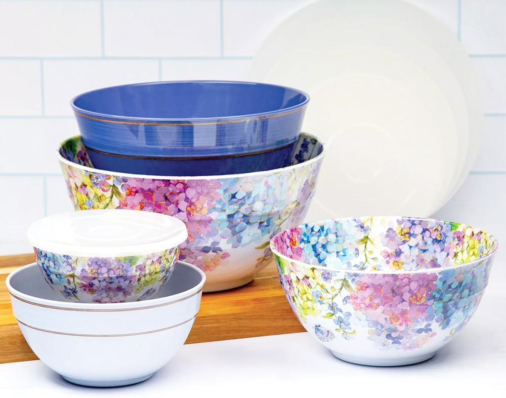 set of floral print mixing bowls on kitchen counter with plastic lids in background