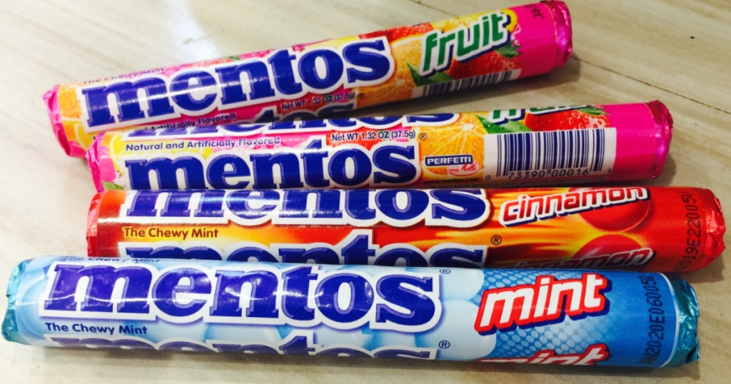 four rolls of different flavored mint candy chews