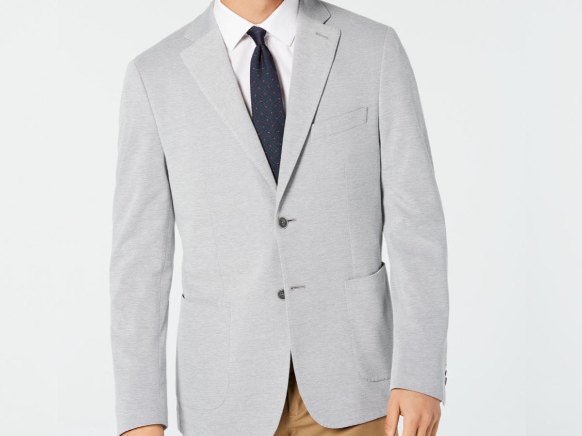 man in gray sports coat