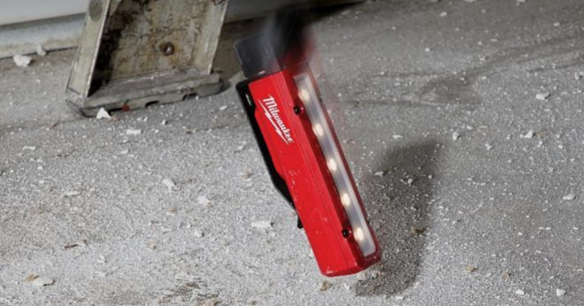 red flood light being dropped on the ground