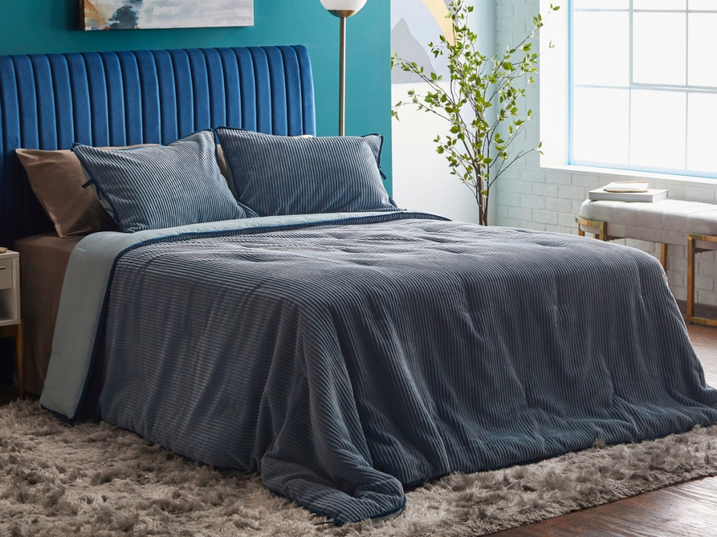bedroom with gray comforter on bed