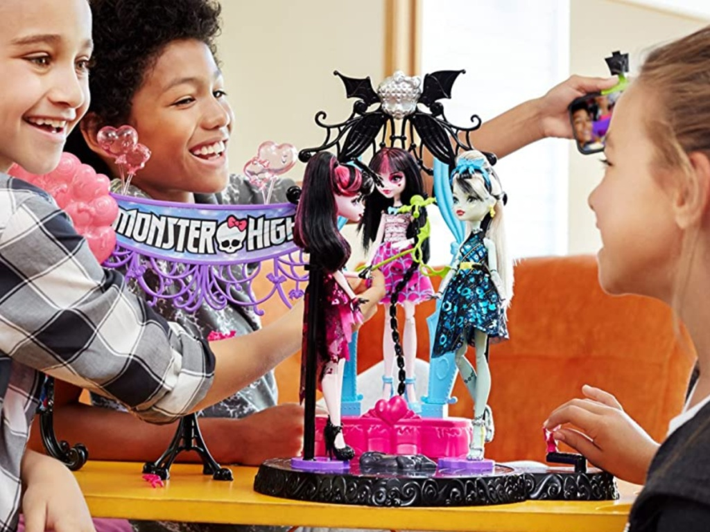 girls playing with doll play set