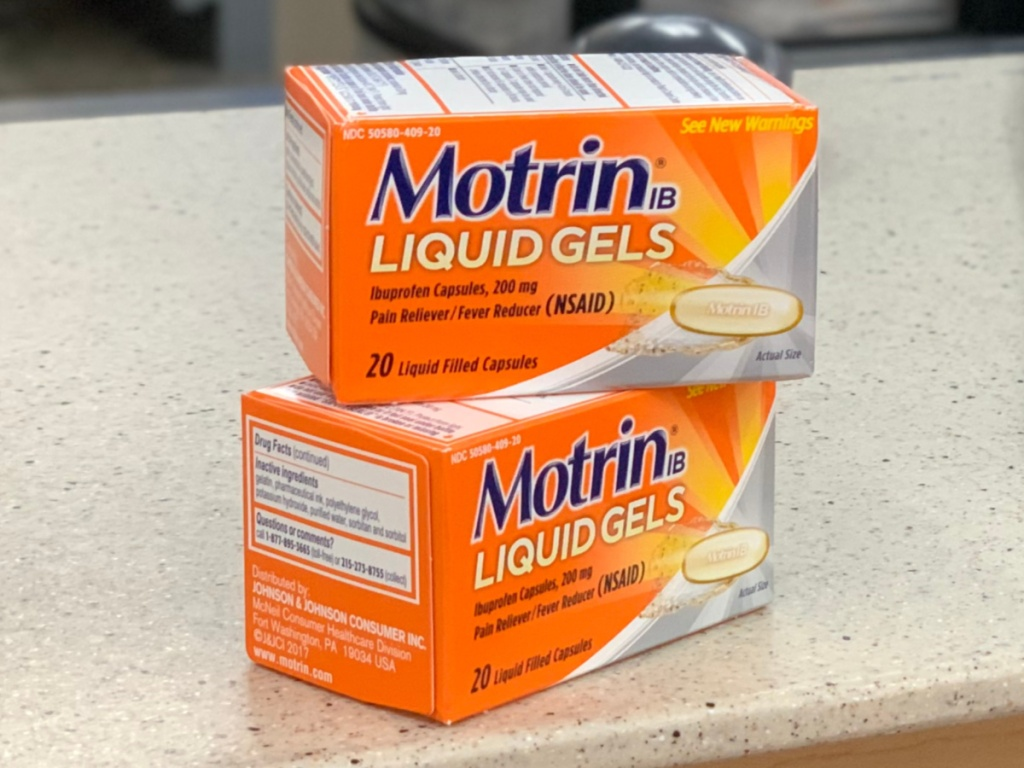 two boxes of pain relievers on counter