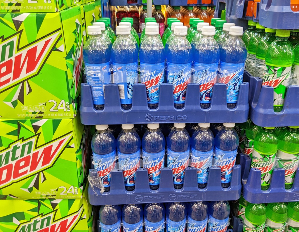 stacks of blue bottles of mountain dew frost bite soda in soda aisle of store