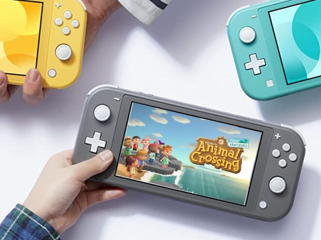nintendo switch console in child's hand