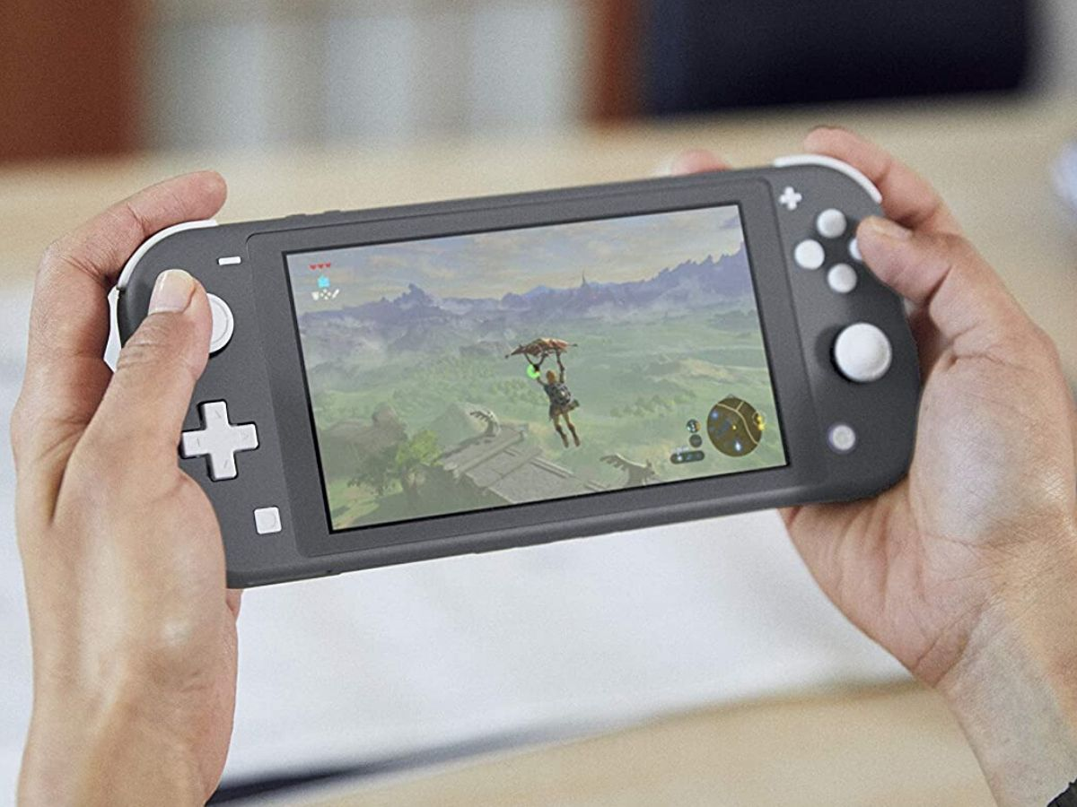 hands playing a nintendo switch gray