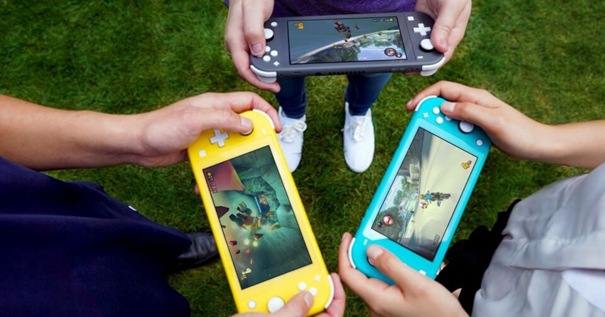 three kids holding nintendo switch lite handheld consoles