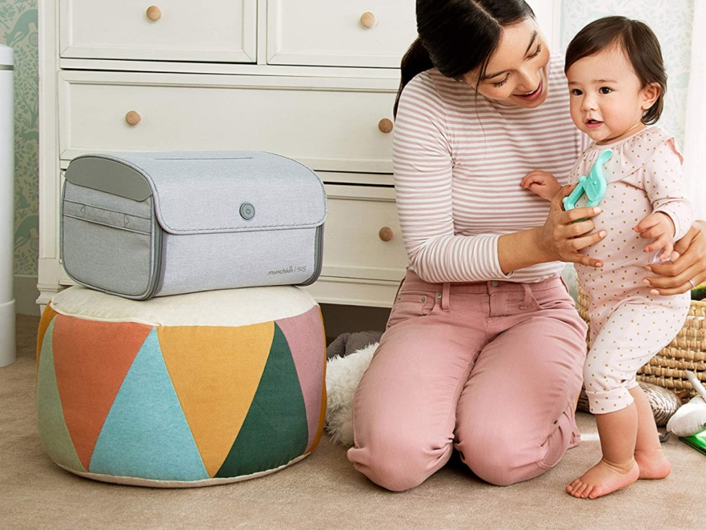 woman and baby with sanitizer bag on bean bag