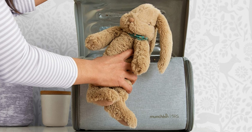 hand placing stuffed bunny in sanitizer bag
