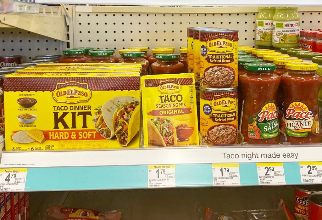 store shelf full of old el paso taco dinner supplies and pace salsa jars