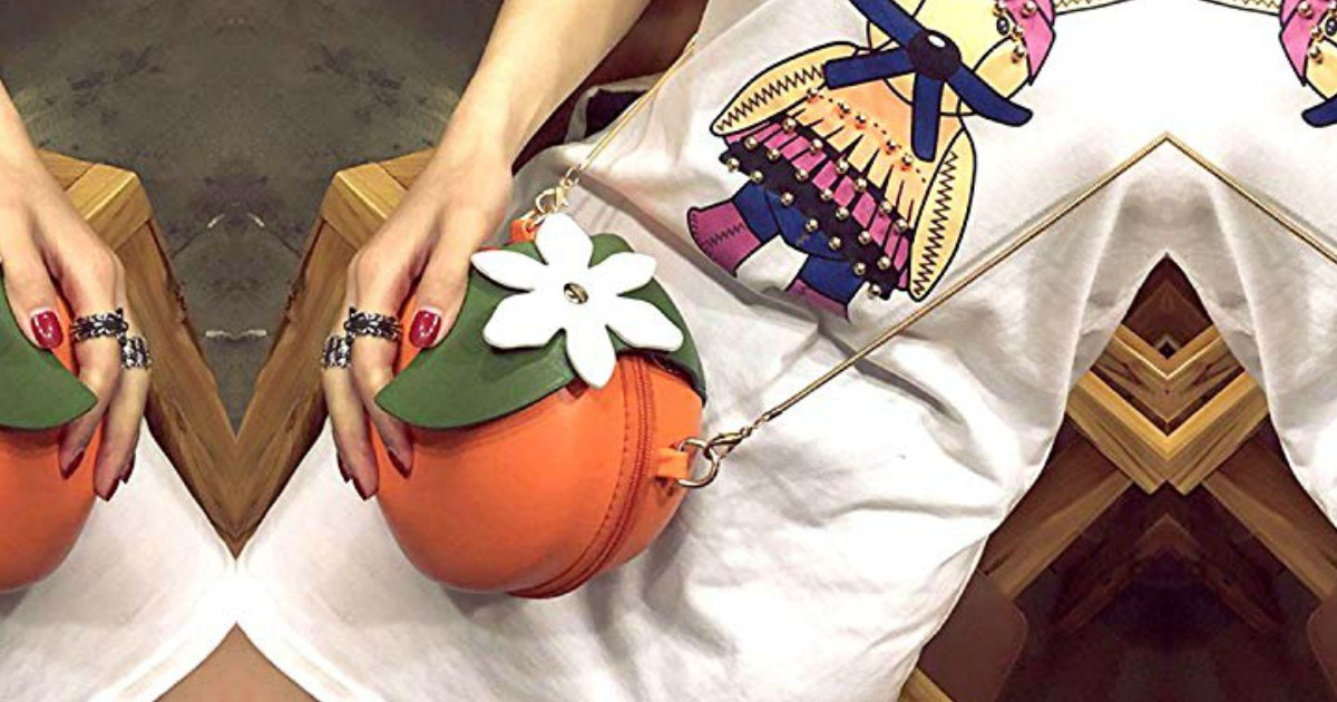 Woman wearing an orange themed purse and a white dress