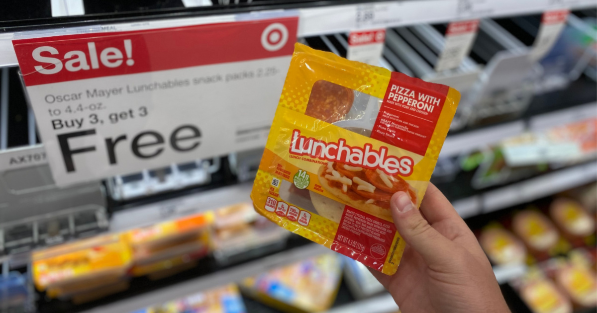 hand holding Lunchables up to sale sign in store