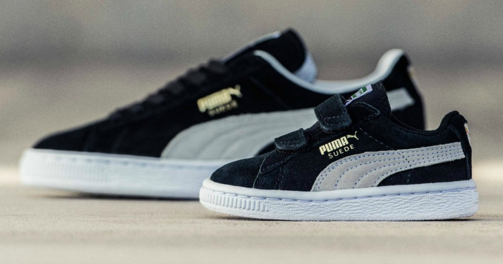 two pairs of PUMA sneakers