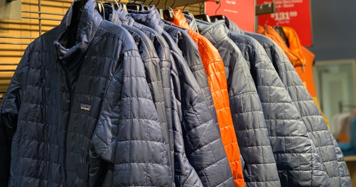 blue silver and orange Patagonia jackets hanging in store