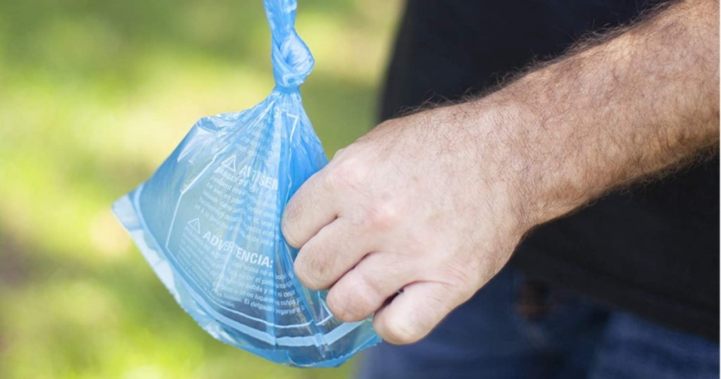 hand carrying blue disposable bag
