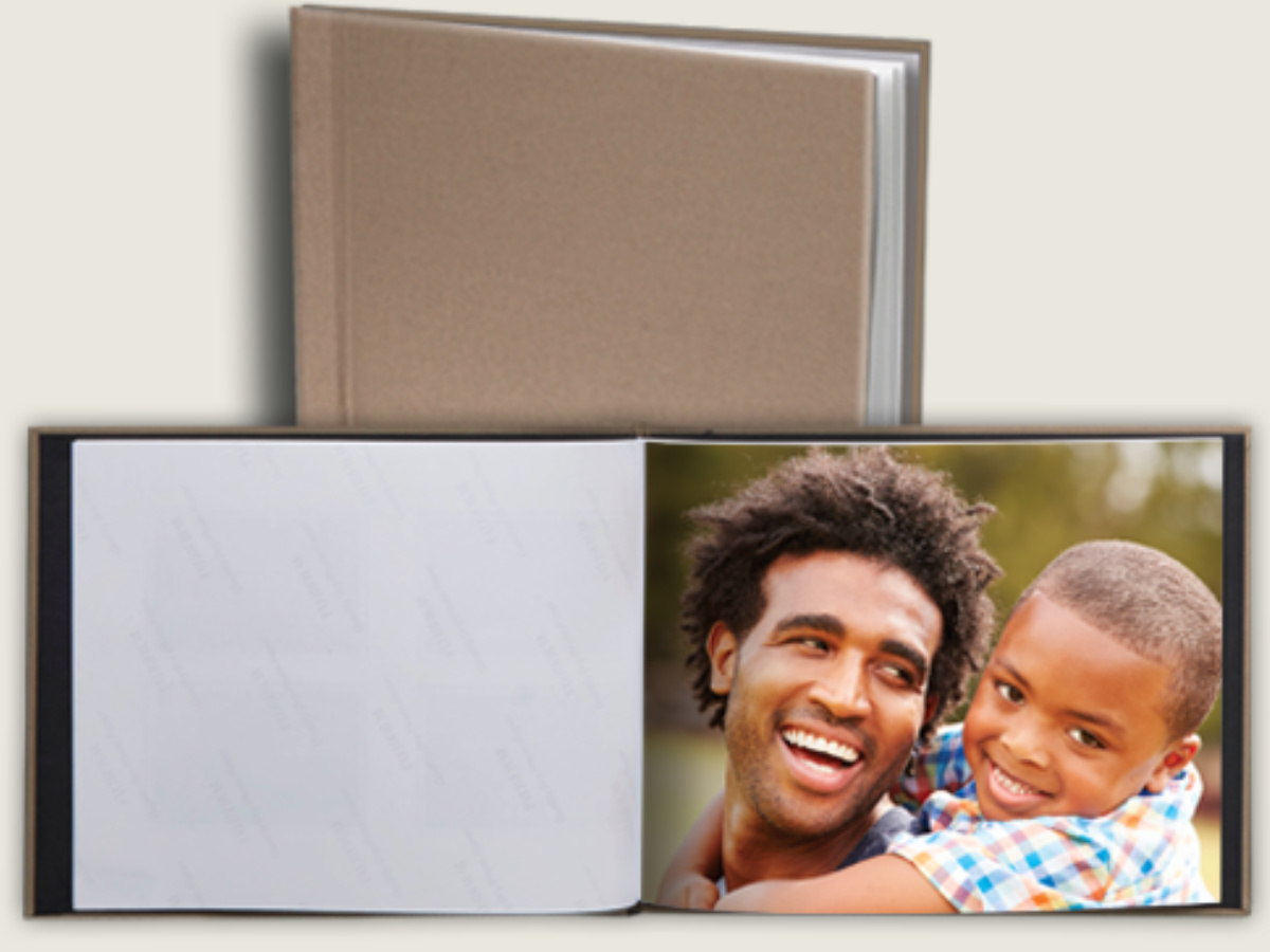 photo book with photo of boy and dad