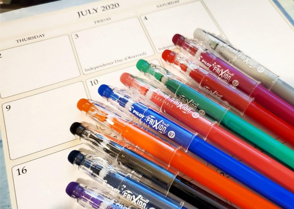 Pilot FriXion Erasable Gel Ink 10-Pack ColorSticks Pens on top of planner
