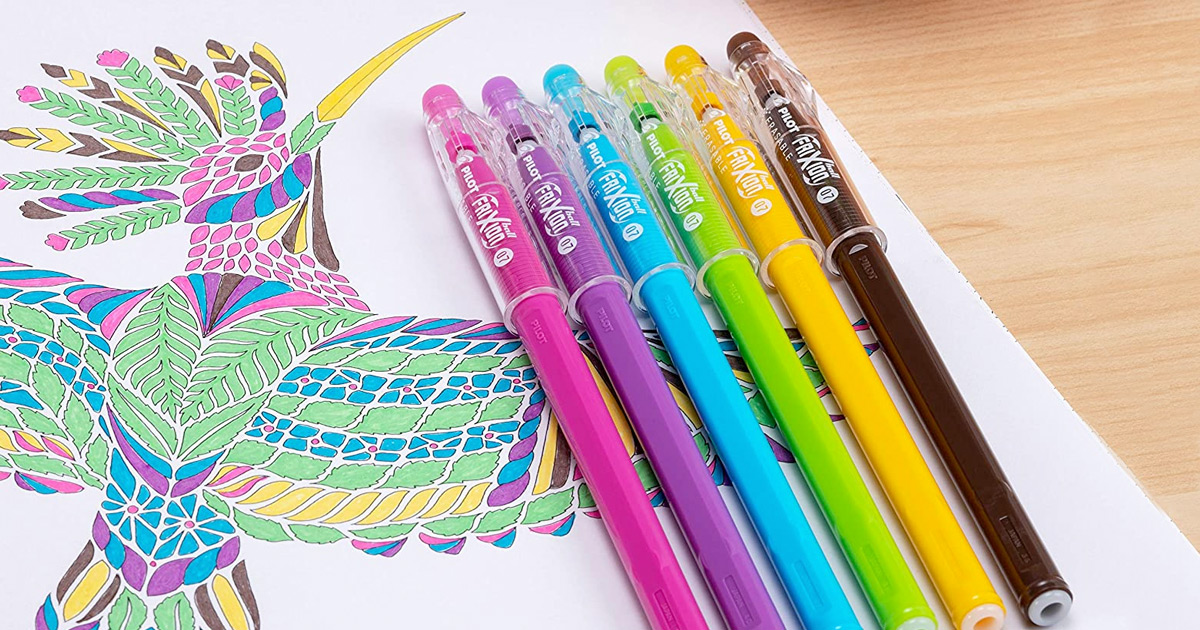 assorted colored pens laying on coloring page with a brightly colored bird