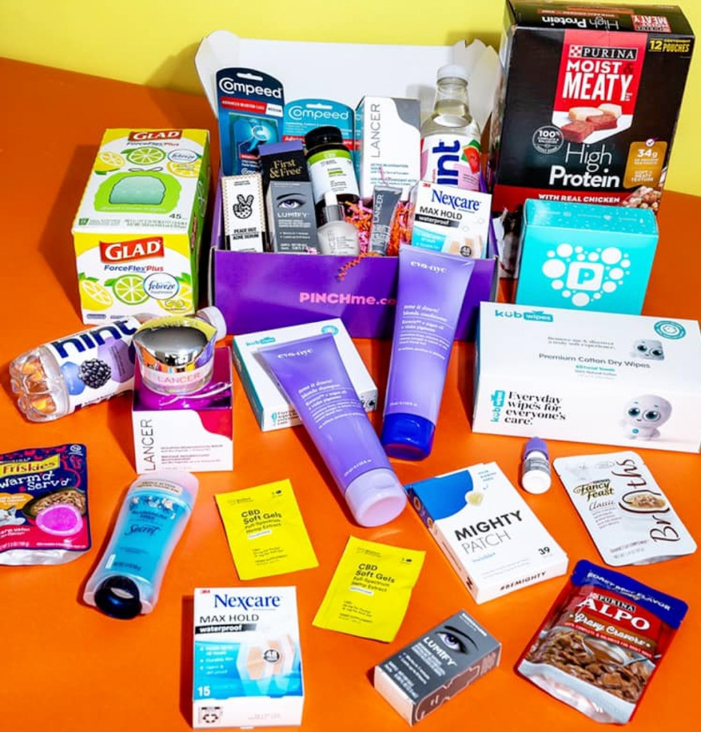 various sample products arranged on orange and yellow background near purple box that says pinchme